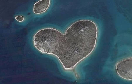 love heart island. Love is in the air, or in this case, on the Earth. This heart-shaped island